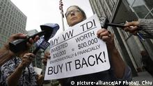 FILE - In this April 21, 2016, file photo, Joyce Ertel Hulbert, owner of a 2015 Volkswagen Golf TDI, holds a sign while interviewed outside of the Phillip Burton Federal Building in San Francisco. A federal judge says Volkswagen has reached a deal to compensate owners and leaseholders of the remaining 80,000 diesel vehicles caught up in the company's emissions cheating scandal. But U.S. District Judge Charles Breyer didn't say Thursday, Dec. 22, 2016, how much the owners and leaseholders would receive on top of a buyback or repairs of their cars. (AP Photo/Jeff Chiu, File) |
