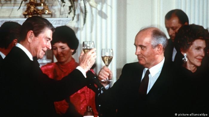 US President Ronald Reagan and Soviet Union President Mikhail Gorbachev with raised glasses in celebration after signing the Intermediate-Range Nuclear Forces Treaty in 1987