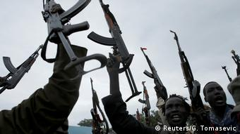 Rebels in south Sudan holding their weapons aloft