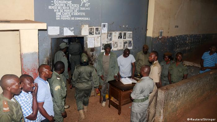 Security forces stand during the release of Anglophone activists at the prison of Yaounde