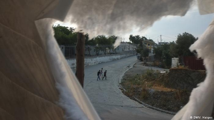 Moria refugee camp seen through a makeshift shelter