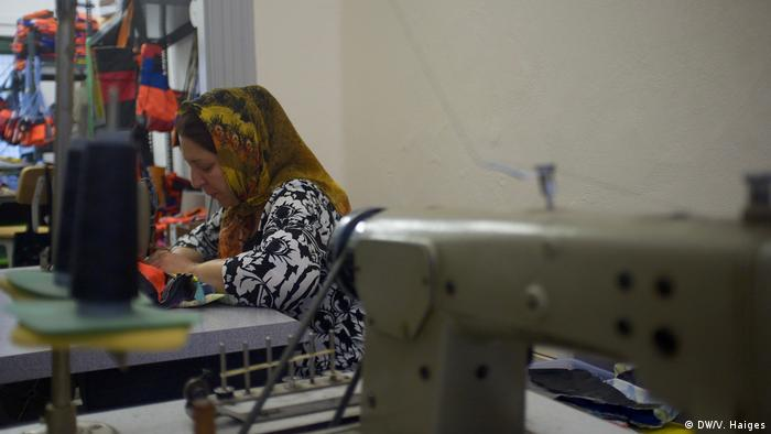 A woman works away at a sewing machine