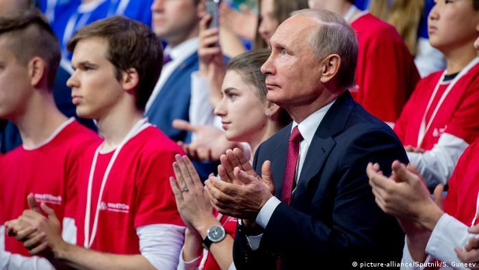 Russian president Vladimir Putin clapping