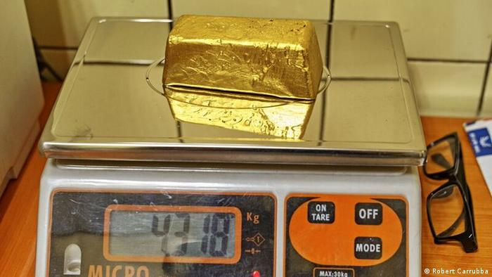shiny gold bar on scales (Robert Carrubba)