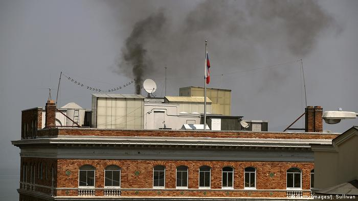 Smoke billows from a chimney on top of the Russian consulate in San Francisco