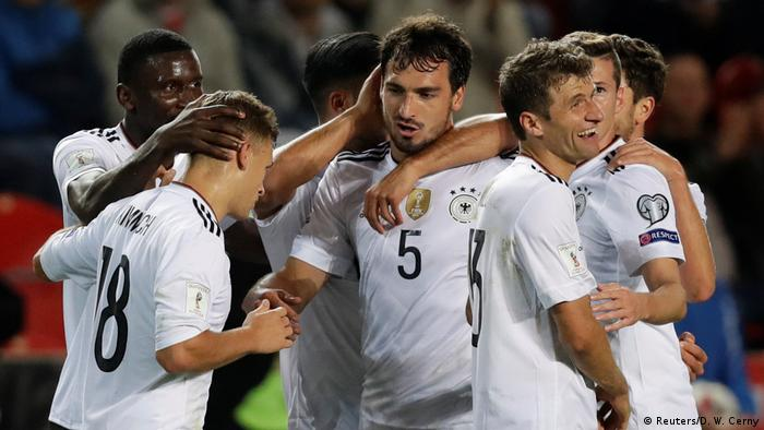 Germany, England tighten grip on World Cup berths
