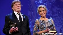 Actors Robert Redford (L) and Jane Fonda receive a Golden Lion award for lifetime achievement at the 74th Venice Film Festival in Venice, Italy, September 1, 2017. REUTERS/Alessandro Bianchi