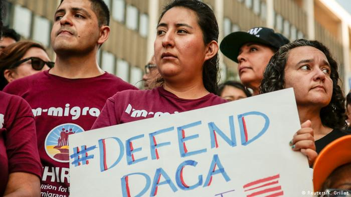 Activists protest against the announcement to end DACA in September 2017
