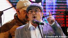 FARC leader Rodrigo Londono, known by his nom de guerre Timochenko, speaks during the launching of the new polÄÄitical party called the Revolutionary Alternative Common Force, at the Plaza de Bolivar in Bogota