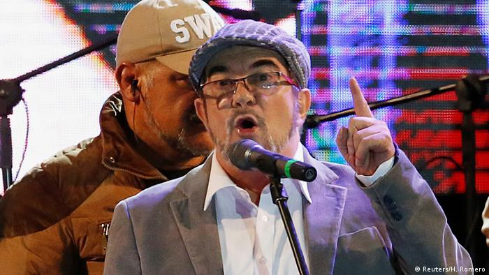 FARC leader Rodrigo Londono, known by his nom de guerre Timochenko, speaks during the launching of the new polÄÄitical party called the Revolutionary Alternative Common Force, at the Plaza de Bolivar in Bogota (Reuters/H. Romero)