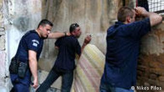 Greek policeman arrests two suspects