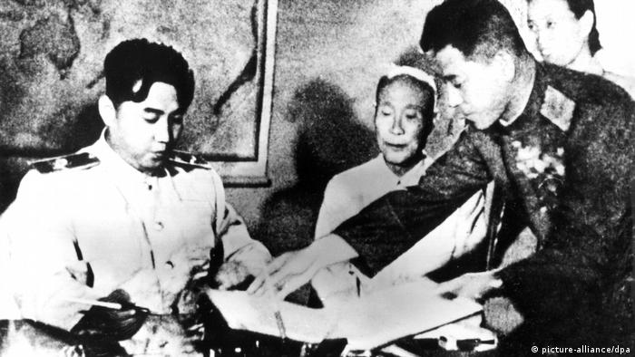 Kim Il Sung signing truce with South Korea