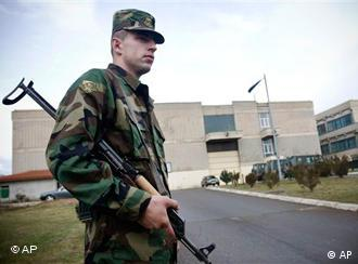 A member of the NATO-trained Kosovo Security Force (KSF) guards the Command and Doctrine Center in Pristina, Kosovo, Jan. 21, 2009. Kosovo armed forces took over security duties on Wednesday, less than a year after the territory declared independence and in the face of strong protests from Serbia. (AP Photo)