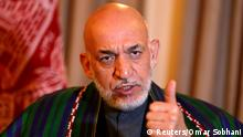 FILE PHOTO - Former Afghan president Karzai speaks during an interview in Kabul