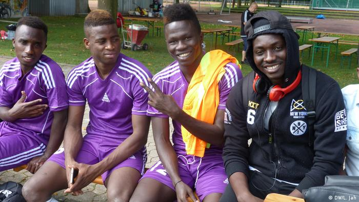 Cologne football- team members happily posing for the pictureDWL Jah