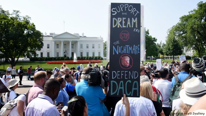 Protesters hold up signs during a rally supporting Deferred Action for Childhood Arrivals