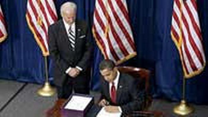 Obama signs the stimulus bill