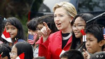 Secretary of State Hillary Rodham Clinton, center, talks with Indonesian junior school students upon her arrival at Halim Perdanakusuma airport in Jakarta, Indonesia, Wednesday, Feb 18, 2009. Secretary of State Clinton is hoping to rehabilitate America's image abroad, especially with Muslims, during a visit to Indonesia and to strengthen economic and development ties with Southeast Asia. (AP Photo/Achmad Ibrahim)