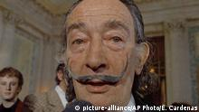 FILE - In this May 21, 1973 file photo, Spanish surrealist painter Salvador Dali, presents his first Chrono-Hologram in Paris, France. A paternity test has disproved a Spanish woman's claim that she is the daughter of surrealist artist Salvador Dali, the deceased painter's foundation announced Wednesday, Sept. 6, 2017. (AP Photo/Eustache Cardenas, File) |
