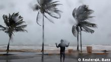 06.09.2017+++Fajardo, Puerto Rico++ A man reacts in the winds and rain as Hurricane Irma slammed across islands in the northern Caribbean on Wednesday, in Luquillo, Puerto Rico September 6, 2017. REUTERS/Alvin Baez