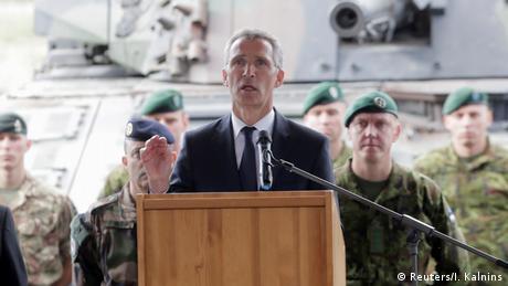 NATo Secretary General Jens Stoltenberg speaks with NATO soldiers in Estonia (Reuters/I. Kalnins)