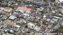 06.09.2017 *** An aerial photography taken and released by the Dutch department of Defense on September 6, 2017 shows the damage of Hurricane Irma in Philipsburg, on the Dutch Caribbean island of Sint Maarten. Hurricane Irma sowed a trail of deadly devastation through the Caribbean on Wednesday, reducing to rubble the tropical islands of Barbuda and St Martin. / AFP PHOTO / ANP / Gerben van Es / Netherlands OUT / RESTRICTED TO EDITORIAL USE - MANDATORY CREDIT AFP PHOTO / DUTCH DEFENSE MINISTRY/GERBEN VAN ES - NO MARKETING NO ADVERTISING CAMPAIGNS - NO ARCHIVES - NO SALE- DISTRIBUTED AS A SERVICE TO CLIENTS (Photo credit should read GERBEN VAN ES/AFP/Getty Images)