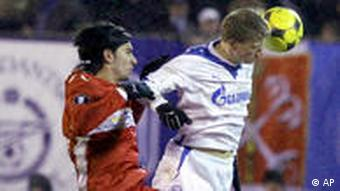 Stuttgart's Serdar Tasci, left, fights for the ball with Zenit's Pavel Pogrebnyak