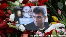 Flowers and a picture at a murder scene of politician Boris Nemtsov, who was shot dead on Moscow's Moskvoretsky bridge