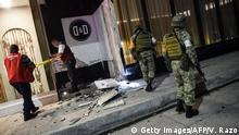 07.09.2017 *** Members of the Mexican army look at damage caused by an earthquake in the Port of Veracuz on September 7, 2017. A rare and powerful 8.4-magnitude earthquake struck southern Mexico late on September 7, killing at least two people as seismologists warned of a tsunami of more than three meters (10 feet). / AFP PHOTO / Victoria RAZO (Photo credit should read VICTORIA RAZO/AFP/Getty Images)