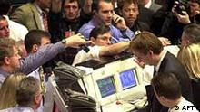 Traders react during hectic trading just after the opening of the stock exchange in Frankfurt/Main, Germany, Monday, April 17, 2000. Amid a steep drop in the German stock market, Europe's largest internet provider T-Online began trading, Monday, at only 28.50 euros (dlrs 27.36), just barely above its 27 euros (dlrs 26) issue price.