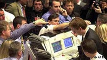 Traders react during hectic trading