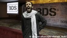 An Egyptian shouts anti-Israeli slogans in front of banners with the Boycott, Divestment and Sanctions (BDS) logo during the launch of the Egyptian campaign that urges boycott, divestment and sanctions against Israel and Israeli-made goods, at the Egyptian Journalists¿ Syndicate in Cairo, Egypt, Monday, April 20, 2015. BDS is a global movement initiated by Palestinian civil society activists in 2005 that organizers say will continue until Israel complies with international law and respects Palestinian rights. (AP Photo/Amr Nabil) |