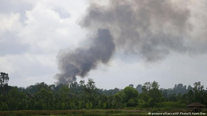 Smoke rises from the Myanmar side of the border with Bangladesh