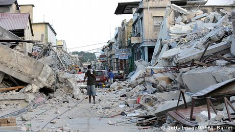 A man walks amid the devastation of the 2010 Haitian earthquake (Getty Images/AFP/J. Barret)