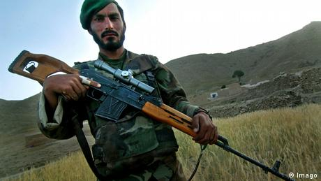 An Afhan soldier showing his Dragunov sniper rifle while patroling with US forces in Afghanistan. (Imago)