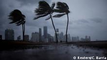 09.09.2017 Dark clouds are seen over Miami's skyline before the arrival of Hurricane Irma to south Florida, U.S. September 9, 2017. REUTERS/Carlos Barria
