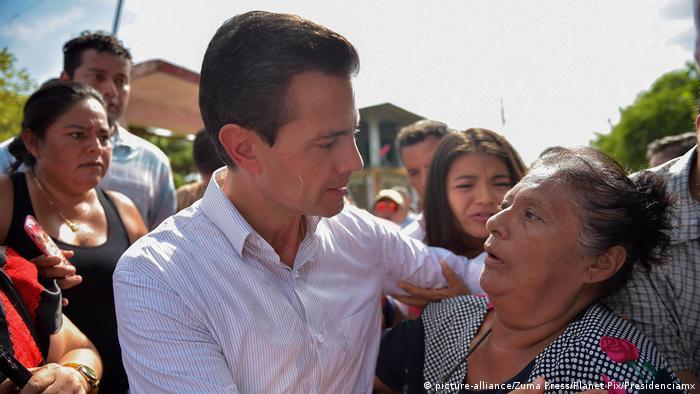 President Pena Nieto with an earthquake survivor in Oaxaca in September