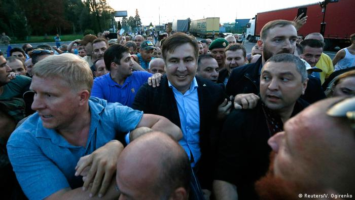 Mikhail Saakashvili and supporters crossing the Polish border into Ukraine