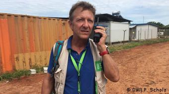 A photo of aid-worker Thomas Hoerz speaking on the phone