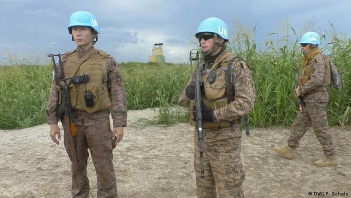 Mongolian UN soldiers wearing distinctive blue helmets