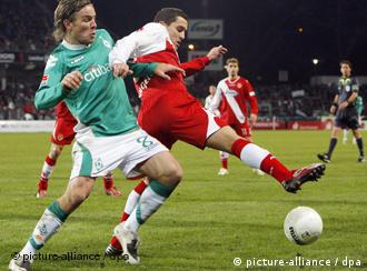 Clemens Fritz, left, challenges for the ball with Dimitar Rangelov