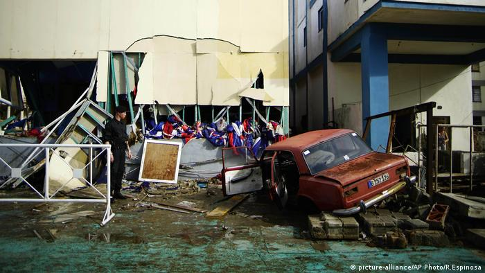 A vehicle lies embedded in the shattered Anti-Imperialist Tribune Building in Cuba