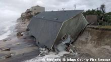 A firefighter views a collapsed coastal house after Hurricane Irma passed the area in Vilano Beach, Florida, U.S. September 11, 2017. St Johns County Fire Rescue/Handout via REUTERS. ATTENTION EDITORS - THIS IMAGE WAS PROVIDED BY A THIRD PARTY TPX IMAGES OF THE DAY