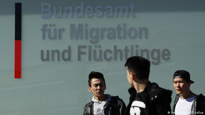 Young men outside the Federal Office for Migrants and Refugees in Berlin (2017)