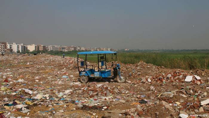 Construction debris is dumped along the river Yamuna in Delhi