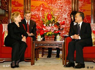 U.S. Secretary of State Hillary Clinton, left, with Chinese Premier Wen Jiabao in Beijing