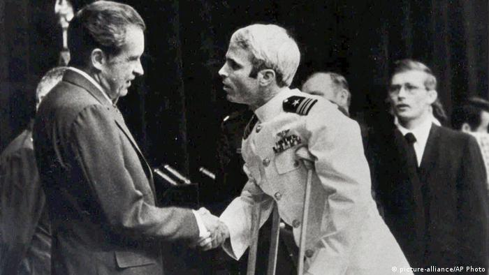McCain, on crutches, shakes President Richard Nixon's hand