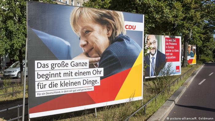 The party campaign billboard from 2017 features Angela Merkel and her opponent Martin Schulz