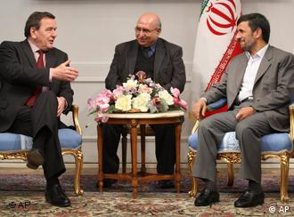 Former German Chancellor Gerhard Schroeder, left, speaks with Iranian President Mahmoud Ahmadinejad, right, during their meeting in Tehran, Iran, Saturday, Feb. 21, 2009. An unidentified translator sits at center. (AP Photo/Fars News Agency, Hossein Salmanzadeh)