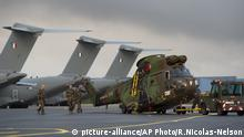 In this photo provided on Saturday Sept. 9, 2017 by the French Defence Ministry, French military transport planes and helicopters on the tarmac at Orleans, France, before heading off to Guadeloupe. French military spokesman Col. Patrik Steiger told The Associated Press military transport planes and helicopters are taking personnel and aid to the local population of the French island of Guadeloupe after the devastation caused by hurricane Irma. (R. Nicolas-Nelson/French Defence Ministry via AP)  